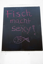 Germany, Hamburg, Dockland, Commercial sign for fish dish - HLF000851