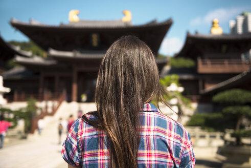 China, Hong Kong, Kowloon, back view of woman visiting Chi Lin nunnery - GEMF000095