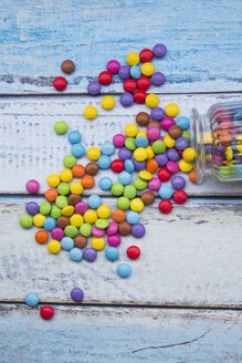 Smarties and candy jar on light blue wood - LVF002976