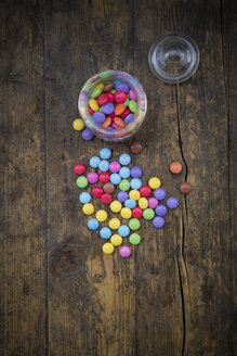 Smarties, candy jar and glass cover on wood - LVF002983