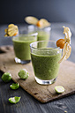 Green smoothie with brussel sprout, banana and apple juice garnished with physalis - IPF000210