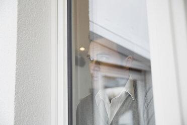 Man looking through window - PDF000864