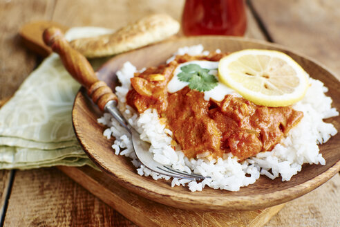 Seitan Tikka Masala on rice with soy yogurt and served with paratha bread - HAWF000707