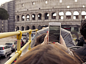 Italy, Rome, Tourists doing sightseeing tour in tour bus, passing Colosseum - LAF001342