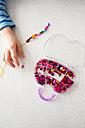 Girl stringing pearls - LVF003002