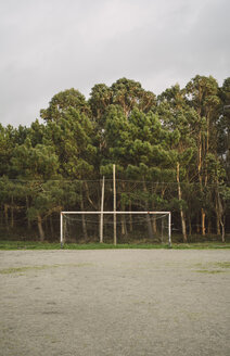 Spain, Galicia, Valdovino, abandoned soccer goal with trees behind - RAEF000073