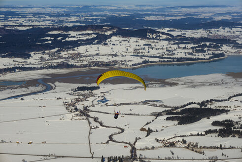 Germany, Bavaria, Swabia, East Allgaeu, Paraglider, Forggensee lake in the background - WG000622