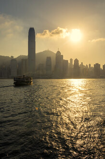 China, Hong Kong skyline from the sea at sunset - GEMF000105