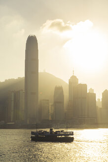 China, Hong Kong skyline from the sea at sunset - GEMF000107