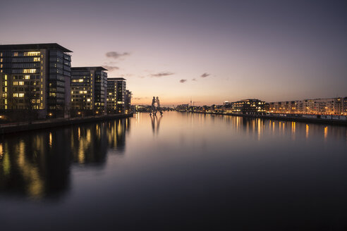 Germany, Berlin, buildings and Molecule Man at River Spree in the evening - ZMF000370