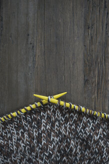 Knitting on dark wood - CRF002644