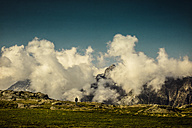 France, Lombardy, near Chiareggio, View to cloud-covered alps, lonely man - DWIF000455