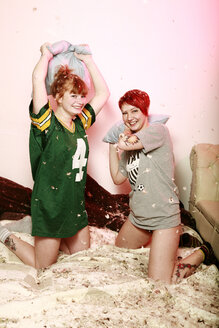 Pillow fight between two female friends at home - VEF000053