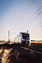Germany, Burgstemmen, driving regional train at rural scene - EVGF001333