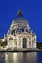 Italy, Venice, Basilica di Santa Maria della Salute at Grand Canal illuminated at night - RUEF001521