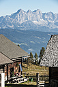 Austria, Altenmarkt-Zauchensee, couple at alpine cabin in mountainscape - HHF005147