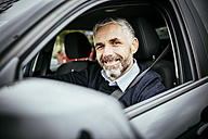 Smiling man driving car - MBEF001321