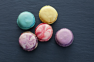 Five different macarons on slate - CSF024879