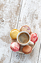 Cup of coffee with five macarons on saucer - CSF024886