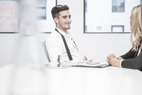 Businessman and businesswoman having an office meeting - ZEF004519