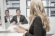 Businessman and businesswoman working in meeting room - ZEF004534