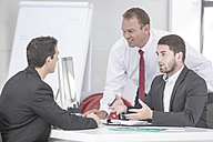 Three businessmen having an office meeting - ZEF004661