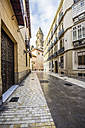 Spain, Andalusia, Malaga, Old town, alley and Cathedral of Malaga in the background - THAF001273