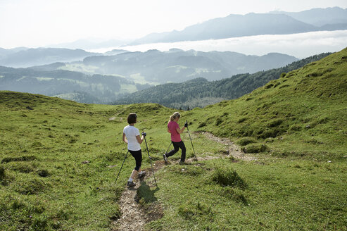 Austria, Two women Nordic walking at Kranzhorn - MAOF000065
