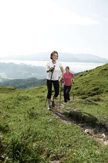 Austria, Two women Nordic walking at Kranzhorn - MAOF000069