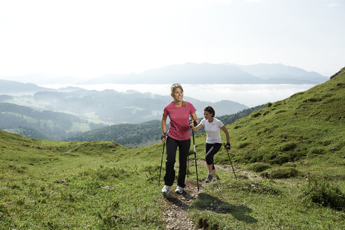 Austria, Two women Nordic walking at Kranzhorn - MAOF000070