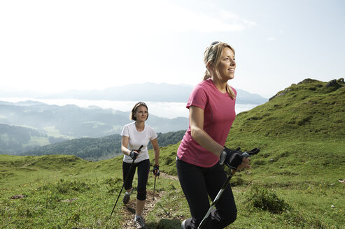 Austria, Two women Nordic walking at Kranzhorn - MAOF000071