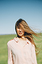 Portrait of young woman with windswept long hair - JPF000030