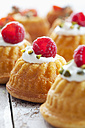 Mini Gugelhupf filled with cream cheese and ricotta garnished with raspberry and pistachio - CSF024934