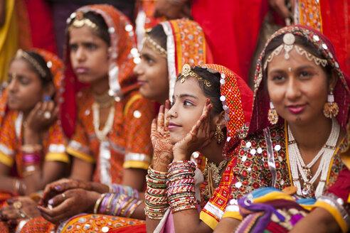 India, Rajasthan, Pushkar, young women at camel market Pushkar Mela wearing typical traditional clothing - PC000085