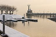 Germany, Baden-Wuerttemberg, Constance, Lake Constance, Harbour entrance with Imperia Statue in winter - KEBF000053