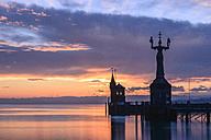 Germany, Baden-Wuerttemberg, Constance, Lake Constance, Harbour entrance with Imperia Statue in winter, Sunrise - KEBF000056