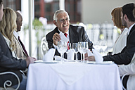 Business people having business lunch in restaurant - ZEF004132