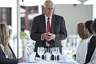 Business people having business lunch in restaurant - ZEF004133