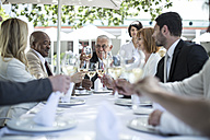 Business people having business lunch in restaurant - ZEF004168