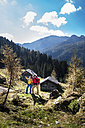 Austria, Altenmarkt-Zauchensee, young couple looking at view - HHF005162