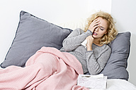 Sick woman lying on couch - MAEF009934