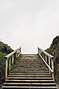Spain, Galicia, Ferrol, wooden staircase with sky above - RAEF000081