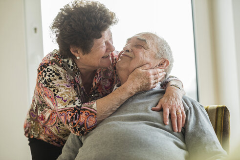 Happy senior couple at home - UUF003565