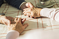 Senior couple holding hands - UUF003598