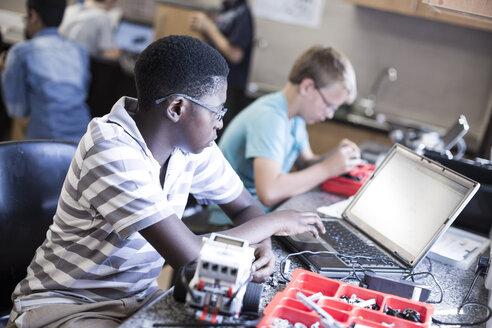 Schoolboys with laptop in robotics class - ZEF006088