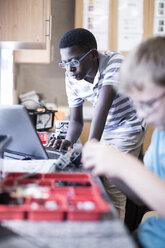 Schoolboys with laptop in robotics class - ZEF006091