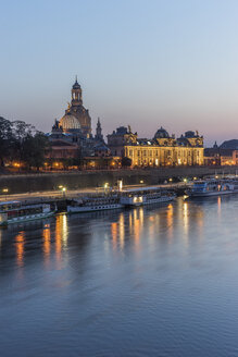 Germany, Dresden, lighted Old city in the evening with Elbe River in the foreground - PVC000307