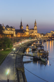 Germany, Dresden, lighted Old city in the evening with steam boats on Elbe River in the foreground - PVC000308