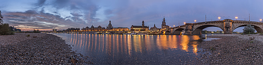 Germany, Dresden, view to lighted Old city with riverside of Elbe River in the foreground at morning twilight - PVC000316