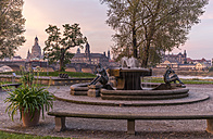 Germany, Dresden, view to skyline with fountain in the foreground at morning twilight - PVC000317